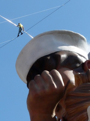Nik Wallanda tightrope walking over the Unconditional Surrender statue bayside